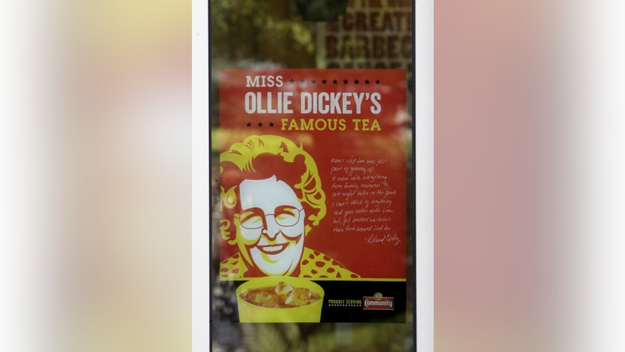 A sign in the window of Dickey's Barbecue Pit is shown Monday, Aug. 18, 2014, in South Jordan, Utah. The Utah police agency investigating how iced tea that a woman drank at a restaurant ended up laced with an industrial cleaning solution is forwarding its findings to prosecutors to determine if anybody should be charged. Authorities have said an employee at Dickey's Barbecue in South Jordan unintentionally put the heavy-duty cleaner in a sugar bag, and a worker later mistakenly mixed it into the iced tea dispenser. (AP Photo/Rick Bowmer)