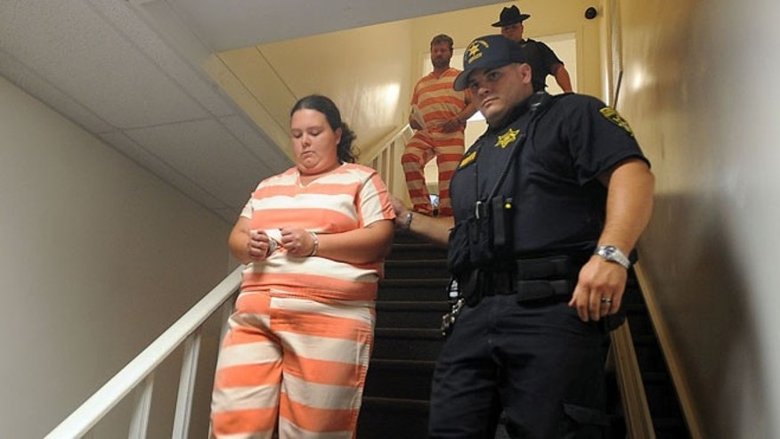 Aug. 15: Deputies from the St. Lawrence County Sheriff's Department escort Nicole F. Vaisey, left, and Stephen M. Howells II, to their arraignment on first-degree kidnapping charges at Fowler Town Court in Fowler, N.Y.