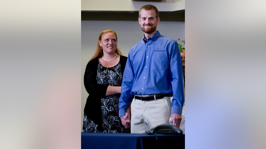 Ebola victim Dr. Kent Brantly stands with his wife, Amber, during a news conference after being released from Emory University Hospital, Thursday, Aug. 21, 2014, in Atlanta. Another American aid worker, Nancy Writebol, who was also infected with the Ebola virus, was released from the hospital Tuesday. (AP Photo/John Bazemore)