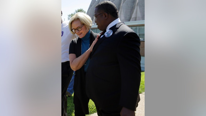 FILE - In this Aug. 14, 2014 file photo Missouri Sen. Claire McCaskill, left, and Rev. Spencer Lamar Booker leave a meeting of clergy and community members in Florissant, Mo., held to discuss law enforcement's response to demonstrations over the killing of Michael Brown Jr.  McCaskill told The Associated Press Friday, Aug. 22, 2014  she's pushing for federal and local investigations to be completed around the same time so that all evidence can be made public. It's a step many consider important should prosecutors decide not to charge the officer. (AP Photo/Jeff Roberson, File)