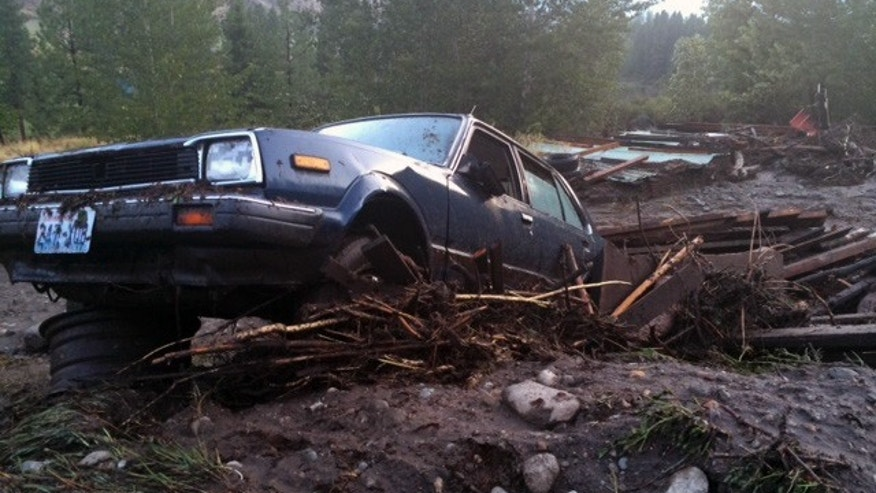 This image made from a video provided by KOMO News shows damage in north central Washington after rain created mudslides on Friday, Aug. 22, 2014. The land, which was left bare by wildfires, washed down hillsides, damaged homes and closed highways. (AP Photo/KOMO News) SEATTLE OUT