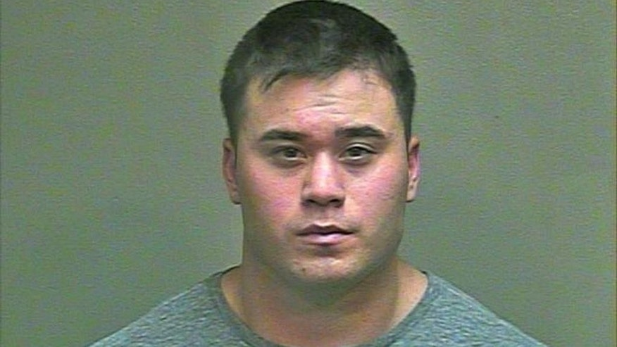 This Aug. 21, 2014 photo made available by the Oklahoma County Sheriff's Office shows Daniel K. Holtzclaw. The 27-year-old Oklahoma City police officer was arrested Thursday, Aug. 21, 2014 and is being held in lieu of $5 million bond after being accused of committing a series of sexual assaults against at least six women while on duty. (AP Photo/Oklahoma County Sheriff's Office)