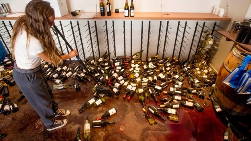 Aug. 24, 2014: Grace Hardy cleans up wine bottles at nakedwines.com in Napa, Calif., following an earthquake.  Winemakers in Californias storied Napa Valley woke up to thousands of broken bottles, barrels and gallons of ruined wine as a result of Sundays earthquake.