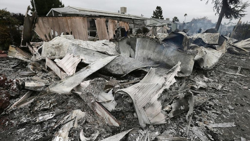 The remains of a mobile home are seen after a gas fire destroyed it as the result of a magnitude 6.0 earthquake Sunday, Aug. 24, 2014, at the Napa Valley Mobile Home Park, in Napa, Calif. A large earthquake caused significant damage and left at least three critically injured in California's northern Bay Area early Sunday, igniting fires, sending at least 87 people to a hospital, knocking out power to tens of thousands and sending residents running out of their homes in the darkness. (AP Photo/Ben Margot)