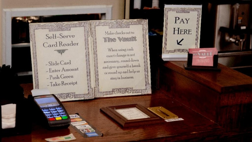 In an Aug. 22, 2014 photo, Instructions abound at 'The Vault', a self-serve coffee shop in downtown Valley City, North Dakota. According to owner David Brekke, small-town living is what allows the North Dakota coffee shop to operate on the honor system.  (AP Photo/Bruce Crummy)