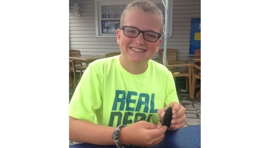 Noah Cordle, 10, found a 10,000-year-old Paleoindian arrow point on a New Jersey beach.