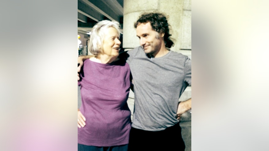 This image provided by the Curtis family shows Nancy Curtis, left, and her son, Peter Theo Curtis, right, in Boston, Tuesday, Aug. 26, 2014. Curtis, a freelance reporter who wrote under the byline Theo Padno and who had been held hostage for about two years in Syria, returned to the U.S. Tuesday. (AP Photo/Curtis Family)