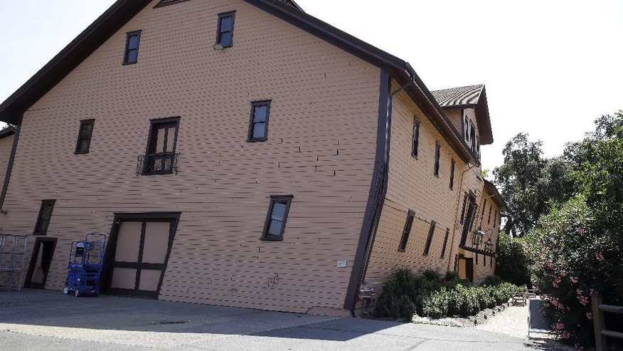 The earthquake-damaged historic winery building dating from 1886 at Trefethen Family Vineyards leans Monday, Aug. 25, 2014, in Napa, Calif. The winery hopes to save the building that is in danger of collapse after San Francisco Bay Area's strongest earthquake in 25 years struck the heart of California's wine country early Sunday. (AP Photo/Eric Risberg)