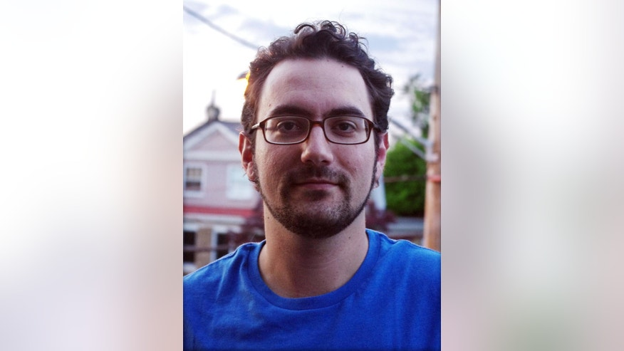 In this Thursday, Aug. 28, 2014 photo Matt Stroud poses for a photo. Stroud, 32, a reporter covering criminal justice for technology website The Verge, is joining The Associated Press as a correspondent based in Morgantown, home of West Virginia University. (AP Photo/Matt Stroud)