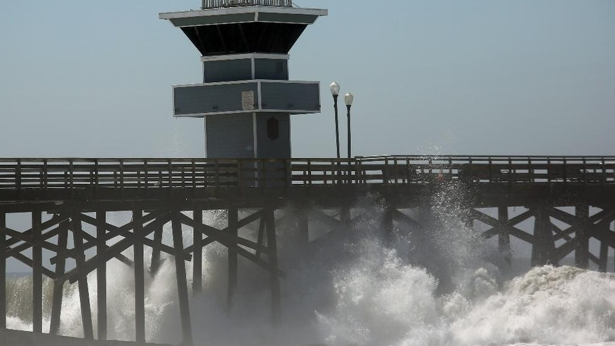 A big wave from Hurricane Marie smashes against the Seal Beach pier in Seal Beach, Calif. on Wednesday, Aug. 27, 2014. The National Weather Service said beaches stretching 100 miles up the Southern California coast would see large waves and rip currents. Swimmers and surfers were urged to be aware of the dangerous conditions. (AP Photo/ Nick Ut )