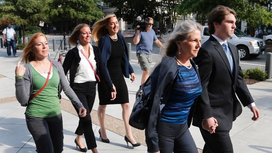 Former Virginia first lady Maureen McDonnell, second from right, holds hands with her son Bobby McDonnell, right, as they arrive at federal court  followed by daughter Cailin Young, left, Rachel McDonnell, second form right, and attorney Heather Martin, center, in Richmond, Va., Thursday, Aug. 28, 2014.  The prosecution in the McDonnell corruption case begins its rebuttal today. (AP Photo/Steve Helber)