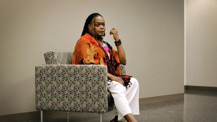 "In this Aug. 26, 2014 picture, Monica Stevens, a transgender woman who runs a support group called Sisters of the T, sits in an interview with The Associated Press in Baltimore. Four killings of transgender women in Baltimore in two years is highlighting the strained relationship between law enforcement and the LGBT community and sparking conversations about how to ease the tension. Some transgender women in Baltimore say the department still has a long way to go before it establishes a solid relationship with them. ""The police should tone down their masculinity so they can really hear what we're saying,"" said Stevens. (AP Photo/Patrick Semansky)"