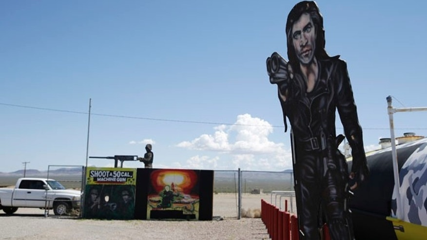 Aug. 27, 2014: Painted signs are seen outside of the Last Stop outdoor shooting range in White Hills, Ariz.