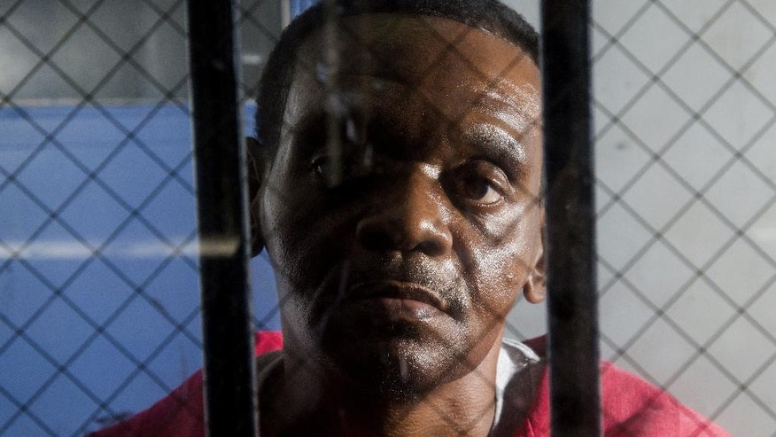 In an an Aug. 12, 2014 photo, Henry McCollum sits on death row at Central Prison in Raleigh, N.C. He and his half brother Leon Brown have spent more than three decades in prison for the rape and murder of 11-year-old Sabrina Buie in 1983. On Tuesday, Sept. 2, 2014, lawyers for Lawyers for 50-year-old McCollum and 46-year-old Brown will ask for their release, saying DNA analysis of a cigarette butt found at the crime scene in Robeson County link it to a man serving a life sentence for a similar rape and killing that took place a month later. The Center for Death Penalty Litigation says that man was the real killer of Sabrina Buie in 1983. (AP Photo/The News & Observer, Travis Long) MANDATORY CREDIT, TV AND TV WEBSITES OUT