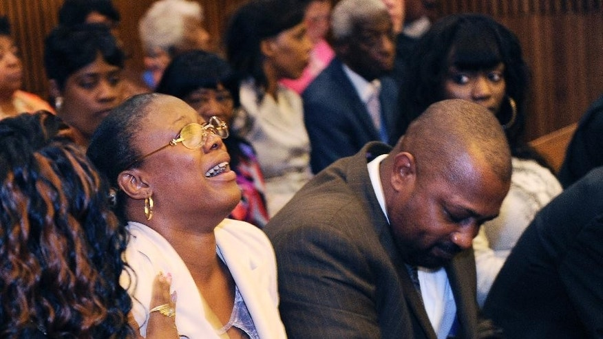 FILE - In this Aug. 7, 2014 file photo, Monica McBride, mother of Renisha McBride cries during the reading of verdict of guilty of of second-degree murder and manslaughter for Theodore Wafer in Detroit. Walter Ray Simmons, Renisha's father, is at right. Wafer  could come face-to-face with Renisha McBride's parents as he receives his sentence for second-degree murder on Wednesday, Sept. 3, 2014.  (AP Photo/The Detroit News, Clarence Tabb Jr.)