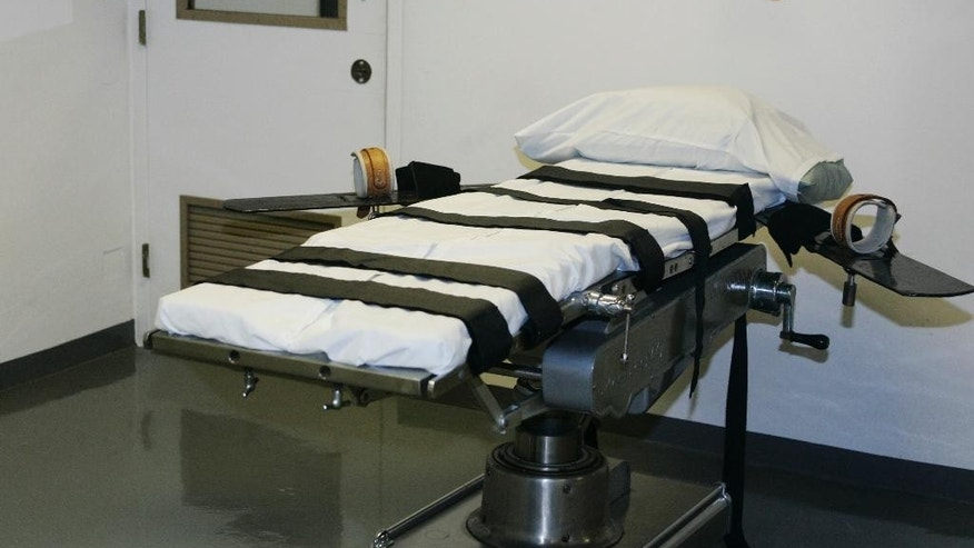 FILE - In this April 15, 2008 file photo, the gurney in the execution chamber at the Oklahoma State Penitentiary is pictured in McAlester, Okla.  Oklahoma investigators are poised to release a report Thursday, Sept. 4, 2014  into the flawed execution of Clayton Lockett, a death row inmate who gasped and writhed on a gurney after being injected with three lethal drugs. Gov. Mary Fallin ordered the investigation after it took 43 minutes to kill  Lockett on April 29. (AP Photo/File)