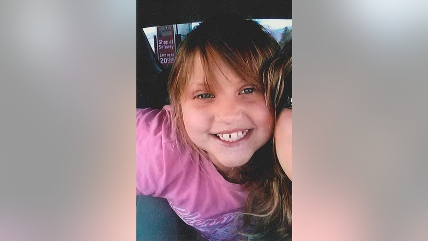 "This undated photo provided by the Bullhead City Police Department shows Isabella ""Bella"" Grogan-Cannella, an 8-year-old Bullhead City, Ariz., girl who was reported missing on Tuesday, Sept. 2, 2014. Police, firefighters and volunteers fanned out in Bullhead city neighborhoods, nearby parks and river areas to look for the missing child. (AP Photo/Courtesy of the Bullhead City Police Department)"