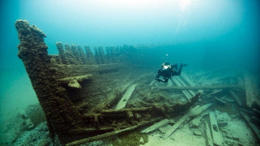 In this May 22, 2013 photo released by the Thunder Bay National Marine Sanctuary, a diver is shown at the Lucinda Van Valkenburg wreckage in the sanctuary boundary waters of Lake Huron near Alpena, Mich. The Thunder Bay National Marine Sanctuary in Michigan has received federal approval to expand its size nearly tenfold and boost preservation of scores of additional shipwrecks in Lake Huron. The only national sanctuary in fresh water announced Friday, Sept. 5, 2014 that the Obama administration approved the years-in-the-making effort to extend it from about 450 square miles to 4,300 square miles. The expansion, which incorporates the waters off Alcona, Alpena and Presque Isle counties in Michigan and to the international border with Canada, also doubles the number of estimated shipwrecks to about 200. (AP Photo/Thunder Bay National Marine Sanctuary)