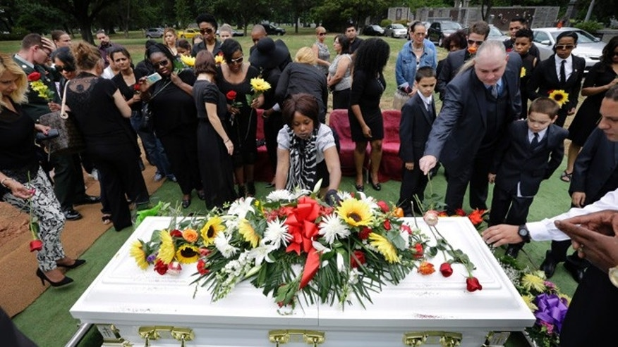 Sept. 5: Friends and family leave flowers on the casket during a funeral service for Maria Fernandes in Linden, N.J.
