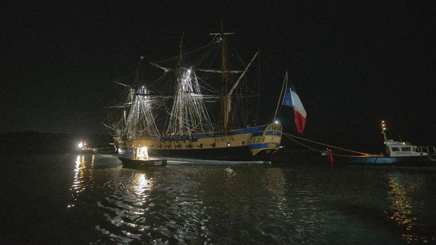 The three masts of the 213 feet long frigate Hermione whose hull is made entirely of oak, maneuvers hours before its first test in the sea in Rochefort, Western France, Saturday, Sept. 6, 2014. Since 1997, in the old dockyard, a passionate team rebuilt the frigate Hermione, which, in 1780, allowed La Fayette to cross the Atlantic to America and join the American rebels in their struggle for independence. The Hermione Lafayette Trip project is aimed to cross the Atlantic in 2015.(AP Photo/Francois Mori)