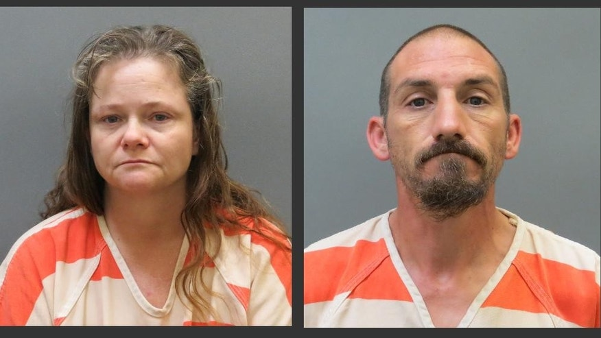 "Kendra Tooley, left, and her boyfriend, Ricky Roy House Jr., are shown in undated photos provided by the Posey County, Ind. Jail. Ron Higgs, the man credited with rescuing a woman allegedly held captive for two months by Tooley, and House Jr., says he he visited his ex-wife, Tooley, and her boyfriend, Thursday, Sept. 4, and was dumbfounded when Tooley told him, ""I've got a girl back here in a cage."" Higgs drove the woman to safety Saturday after convincing House and Tooley that he wouldn't tell police. The Posey County couple now faces preliminary charges of rape and criminal confinement. (AP Photo/Posey County, Ind. Jail)"