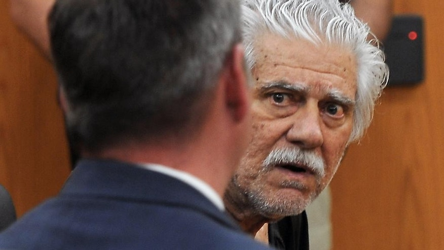 FILE - In this June 2, 2014, file photo, Wayne Burgarello, right, with his public defender Justin Champagne, listens to the judge during his bail hearing in Sparks Justice Court in Sparks, Nev. Burgarello, a former schoolteacher charged with murder and attempted murder in the shootings of two unarmed trespassers at a Sparks home he owned, pleaded not guilty on Wednesday, Sept. 10, 2014 to the charges against him. (AP Photo/The Reno Gazette-Journal, Marilyn Newton, Pool, File)