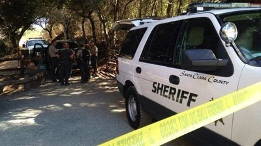 September 10, 2014: Authorities gather at the site where a mountain lion was shot and killed in Cupertino, Calif. (Azenith Smith/Courtesy KTVU)
