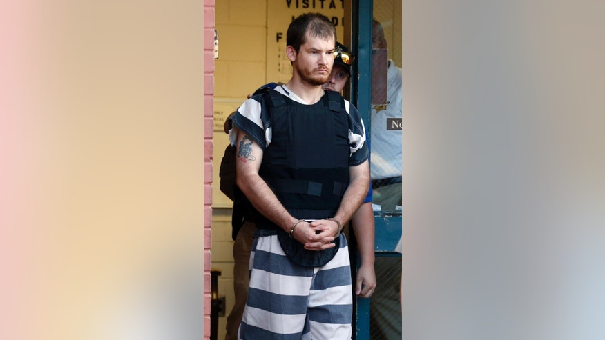 Timothy Ray Jones Jr., is escorted by lawmen out of the Smith County Jail to a vehicle for transport to Lexington County, S.C. on Thursday, Sept. 11, 2014 in Raleigh, Miss. Jones is expected to be charged with murder in the deaths of his five children after he led authorities to a secluded clearing in Alabama on Tuesday where their bodies were found wrapped in garbage bags. (AP Photo/Rogelio V. Solis)