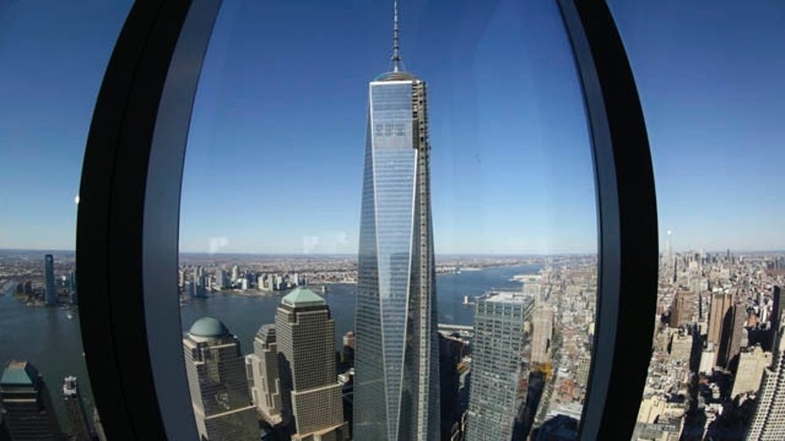 FILE - In this Nov. 13, 2013 file photo, 1 World Trade Center, center, is viewed from the 62nd floor of Four World Trade Center in New York. (AP Photo/Mark Lennihan, File)