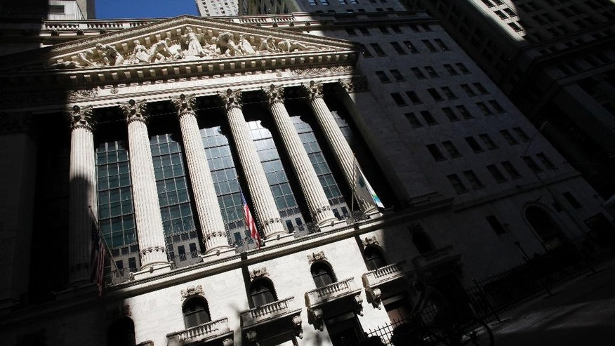 FILE - This July 15, 2013 file photo shows the New York Stock Exchange in New York. Worries over the timing of a U.S. rate hike, economic weakness in China and an impending referendum on Scottish independence kept a lid on global stock markets Wednesday, Sept. 10, 2014. (AP Photo/Mark Lennihan, File)