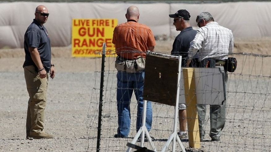 FILE 2014: People seen at the Last Stop outdoor shooting range in White Hills, Ariz. The girl who accidentally killed the shooting range instructor, Charles Vacca, in northern Arizona had said immediately after the shooting that she felt the gun was too much for her and had hurt her shoulder.