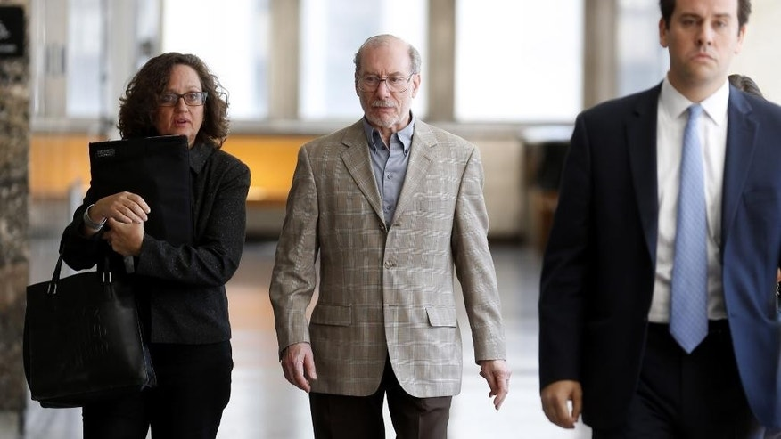 Stan Patz, father of Etan Patz, center, returns to the courtroom after a break in New York, Monday, Sept. 15, 2014. The videotaped confession of Pedro Hernandez, who admitted killing 6-year-old Etan Patz in 1979, is expected to be played in court as a Manhattan judge determines whether it is fair game for the suspect's murder trial. The hearing that begins Monday is expected to last several weeks to determine whether Pedro Hernandez's statements are admissible in the case. (AP Photo/Seth Wenig)