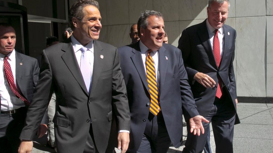 New York Gov. Andrew Cuomo, left, New Jersey Gov., Chris Christie, center, and New York Mayor Bill de Blasio leave a press conference following a security meeting, in New York,  Monday, Sept. 15, 2014.  Govs. Cuomo, Christie and de Blasio met with Homeland Security Secretary Jeh Johnson and a bi-state group of officials from local, state and federal law enforcement and public safety offices to discuss security preparedness and coordination in the New York-New Jersey region. (AP Photo/Richard Drew)