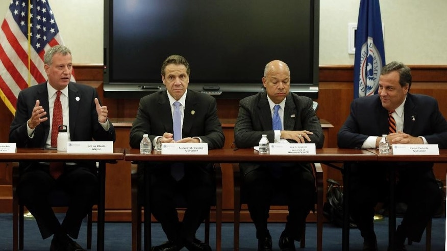 New York Mayor Bill De Blasio, New York Gov. Andrew Cuomo, Homeland Security Secretary Jeh Johnson and New Jersey Gov. Chris Christie, left to right, attend a security conference, in New York, Monday, Sept. 15, 2014. Govs. Cuomo, Christie and Mayor de Blasio met with Secretary Johnson and a bi-state group of officials from local, state and federal law enforcement and public safety offices to discuss security preparedness and coordination in the New York-New Jersey region. (AP Photo/Richard Drew, Pool)