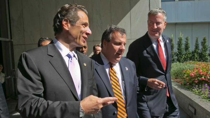 New York Gov. Andrew Cuomo, left, New Jersey Gov. Chris Christie, center, and New York Mayor Bill de Blasio leave a press conference following a security meeting, in New York,  Monday, Sept. 15, 2014.  Govs. Cuomo, Christie and de Blasio met with Homeland Security Secretary Jeh Johnson and a bi-state group of officials from local, state and federal law enforcement and public safety offices to discuss security preparedness and coordination in the New York-New Jersey region. (AP Photo/Richard Drew)