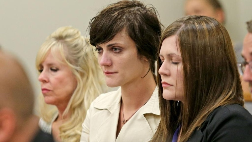 From left, Linda Cluff, sister of Michelle MacNeill, Alexis MacNeill Somers and Rachael MacNeill, listen as their father (and former brother-in-law) Martin MacNeill is sentenced in a forcible sex abuse case by Judge Samuel D. McVey in Fourth District Court, Monday, Sept. 15, 2014, in Provo, Utah. The Utah doctor convicted of killing his wife was sentenced to one to 15 years in prison in a separate sexual abuse case. (AP Photo/Deseret News, Tom Smart, Pool)