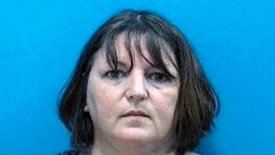 "FILE - This Aug. 6, 2014 file photo provided by the Martin County (Fla.) Sheriff's Office shows Michelle Lodzinski. Middlesex County prosecutors say Lodzinski is due to appear in court, Tuesday, Sept. 16, 2014, in New Brunswick, N.J. She is charged with killing Timothy Wiltsey, but her attorney has said she ""adamantly denies"" the charges. (AP Photo/Martin County (Fla.) Sheriff's Office, File)"