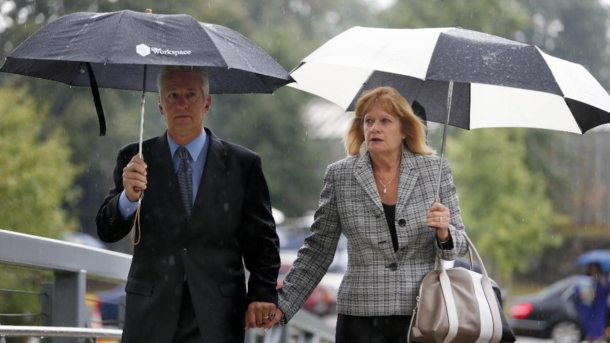 Carol Stewart-Kosic, mother of Lindsey Stewart, and her husband Walter Kosic arrive to the Rockland County Courthouse for the sentencing of Jojo John in New City, N.Y., Tuesday, Sept. 16, 2014. John was sentenced Tuesday to two years behind bars for crashing a powerboat into a barge, killing Lindsey Stewart, a bride-to-be, and her fiance's best man. (AP Photo/Seth Wenig)