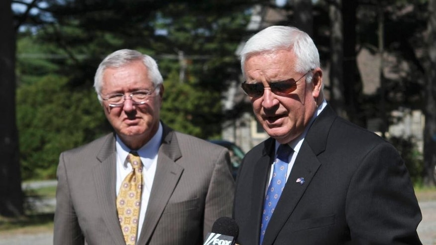 Pennsylvania Gov. Tom Corbett, right, speaks to the press at the Blooming Grove Baptist Church in Pike County, Pa., Monday, Sept. 15, 2014 about the shooting Friday night that took the life of a Pennsylvania State Police trooper and critically injured another.  Corbett said investigators won't rest until they capture the gunman. He flanked by Pennsylvania State Police Commissioner Frank Noonan, left. (AP Photo/The Times-Tribune, Michael J. Mullen)