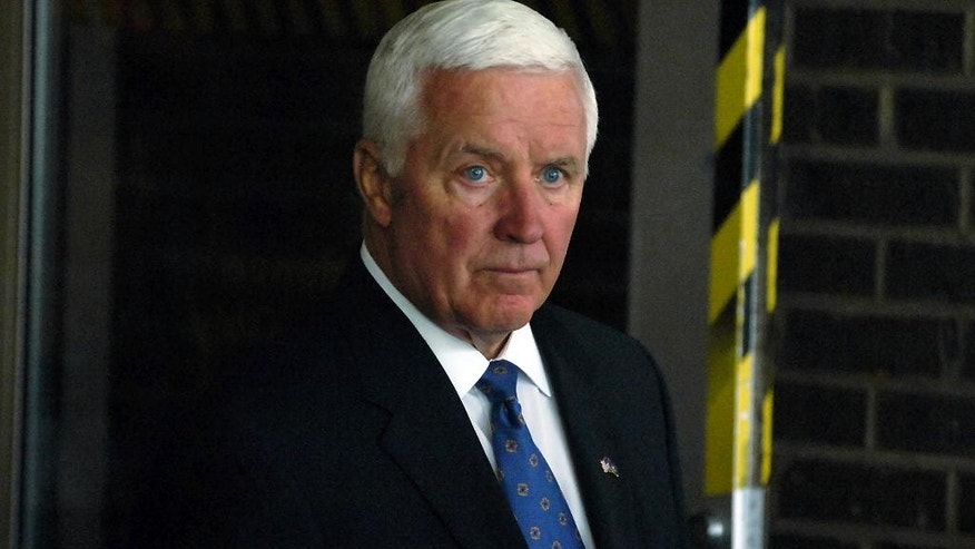 Pennsylvania Gov. Tom Corbett leaves the Geisinger Community Medical Center  after a brief visit with wounded Pennsylvania State Trooper Alex T. Douglass, 31, of Olyphant, Pa. on Monday, Sept. 15, 2014, in Scranton, Pa. Trooper Douglass was involved in a shooting ambush along with fellow state trooper Cpl. Bryon Dickson, 38, of Dunmore, Pa. who was killed on Friday night at the state police barracks in Blooming Grove Township, Pa.  (AP Photo / The Scranton Times-Tribune, Butch Comegys)