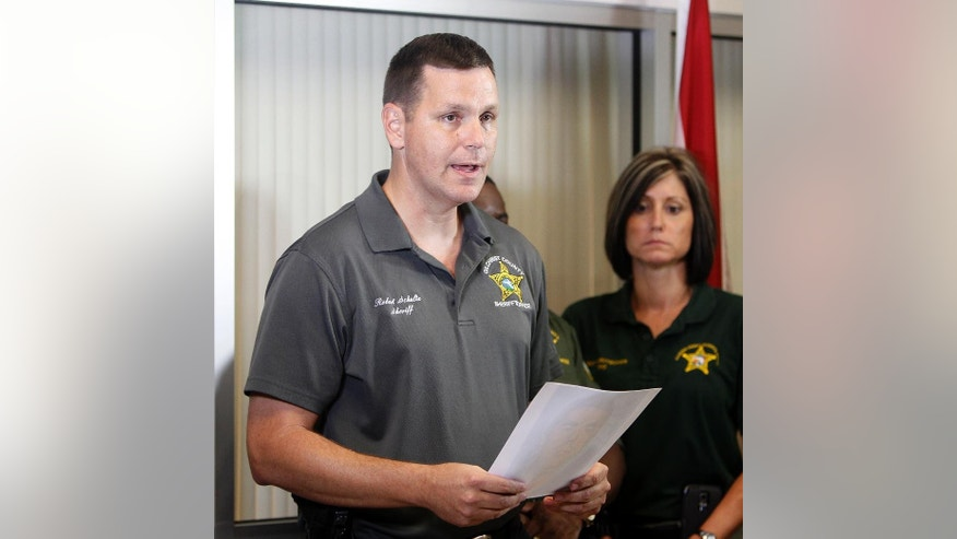 Gilchrist County Sheriff Robert D. Schultz speaks during a news conference in Bell, Fla. on Thursday, Sept. 18, 2014 about a shooting earlier in the day. Officials said two adults and six children are dead in the incident. (AP Photo/The Gainesville Sun, Matt Stamey)