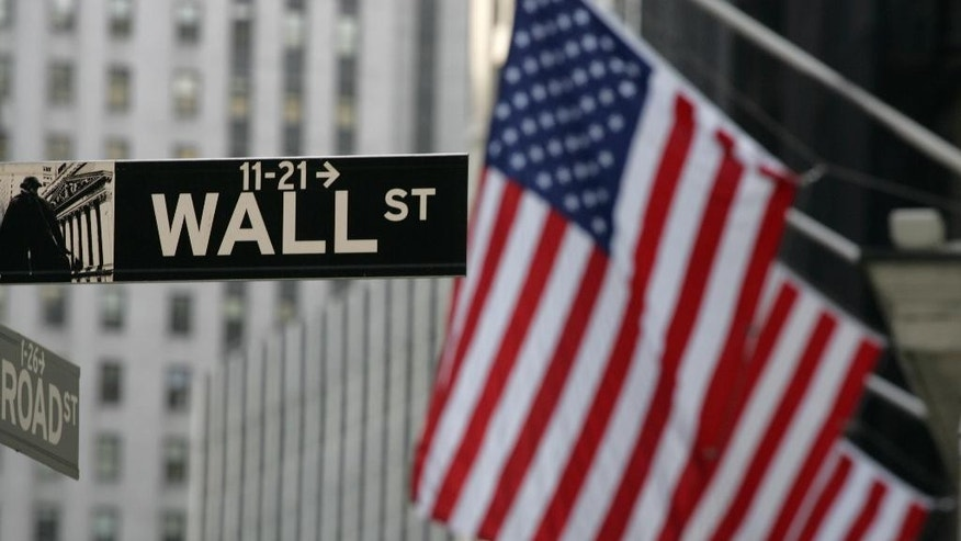 A Wall Street sign is shown Wednesday, Sept. 17, 2008 in New York. World stocks were mostly higher Thursday Sept. 18, 2014 as Scotland voted in an independence referendum that could shake the U.K. economy and markets.  (AP Photo/Mark Lennihan)
