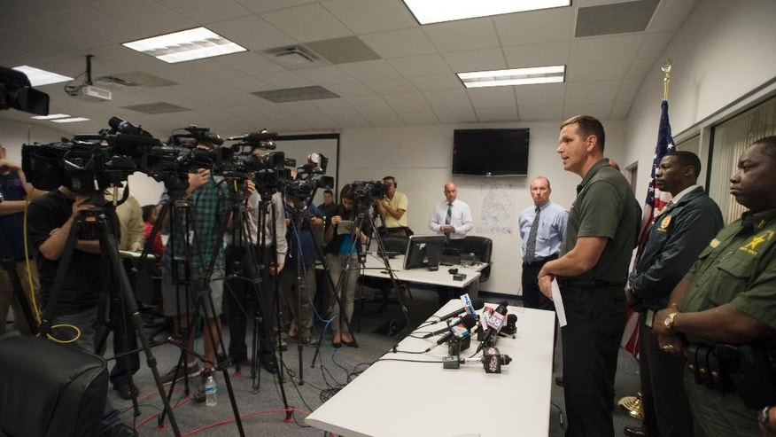 Gilchrist county sheriff Bobby Schultz talks with the media following the shooting deaths of 8 members of a familhy in  Bell, FL, Thursday, Sept., 18, 2014. Schultz said a man killed six of his grandchildren, his adult daughter and himself.  (AP Photo/Phil Sandlin)