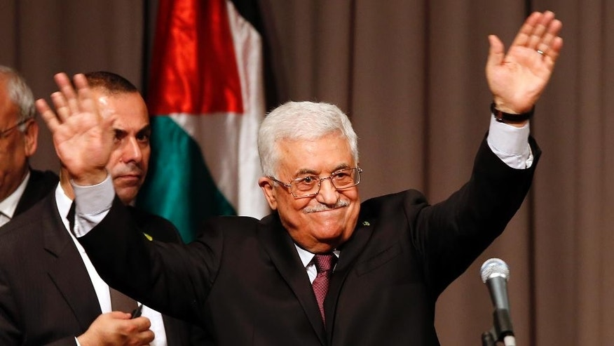 Palestinian President Mahmoud Abbas acknowledges the audience after delivering a speech at Cooper Union, Monday, Sept. 22, 2014, in New York. (AP Photo/Jason DeCrow)