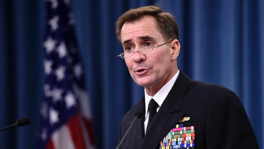 FILE - In this Sept. 2, 2014, file photo, Pentagon press secretary Navy Rear Adm. John Kirby speaks during a briefing at the Pentagon. The Pentagon on Monday night, Sept. 22, says the U.S. and partner nations have begun airstrikes in Syria against Islamic State militants, using a mix of fighter jets, bombers and Tomahawk missiles fired from ships in the region. Kirby says that because the military operation is ongoing, no details can be provided yet. He says the decision to strike was made early Monday by the military. (AP Photo/Susan Walsh, File)