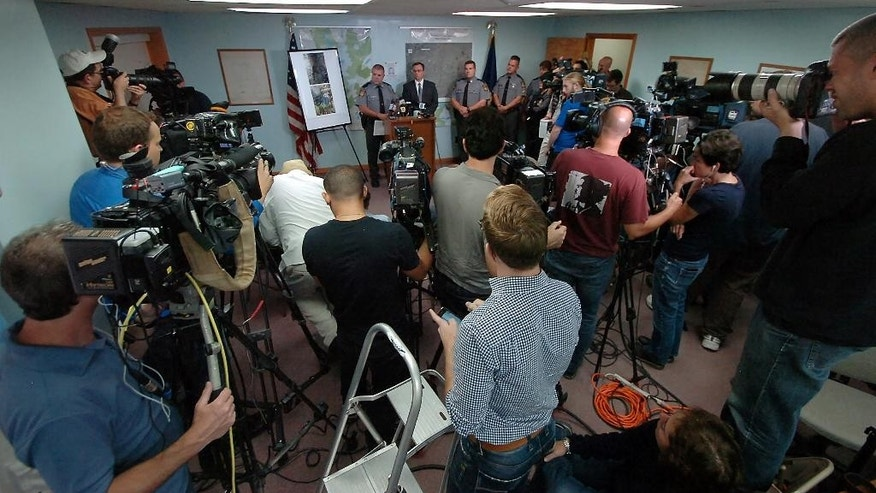 Lt. Col. George Bivens, Deputy Commissioner of Operations for the Pennsylvania State Police, speaks with reporters on Sunday, Sept. 21, 2014, at the Blooming Grove Township Building in Blooming Grove Township, Pa.  (AP Photo / The Scranton Times-Tribune, Butch Comegys)