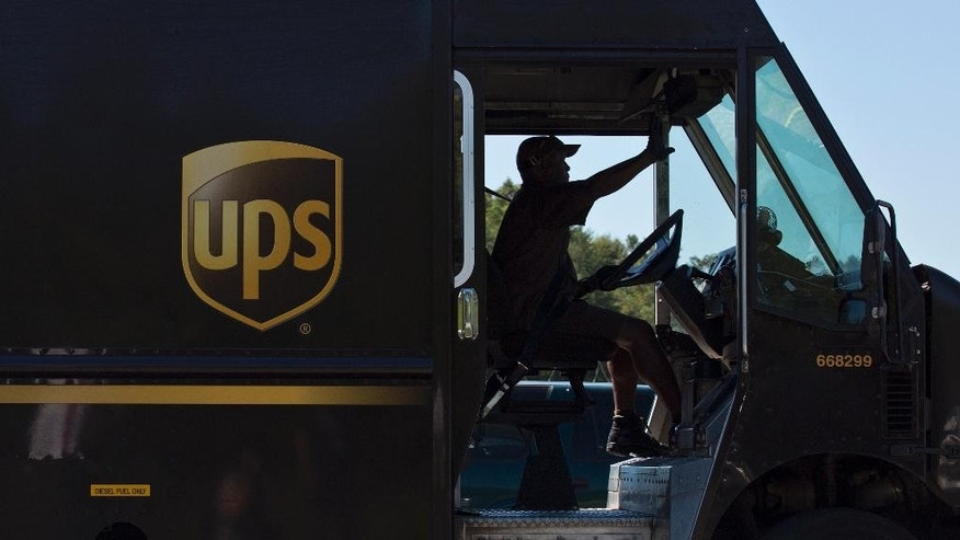 A UPS truck driver enters a company warehouse on Tuesday, Sept. 23, 2014, in Birmingham, Ala. A UPS employee opened fire Tuesday morning inside one of the company's warehouses in Alabama, killing two people before taking his own life, police said.(AP Photo/Brynn Anderson)