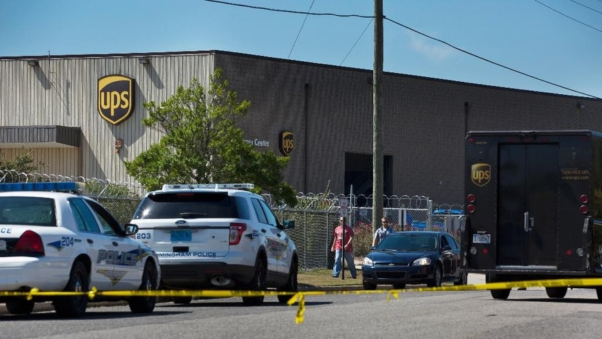 A UPS warehouse has police tape surrounding it on Tuesday, Sept. 23, 2014, in Birmingham, Ala., after a UPS employee opened fire Tuesday morning inside one of the company's warehouses in Alabama, killing two people before taking his own life, police said.(AP Photo/Brynn Anderson)