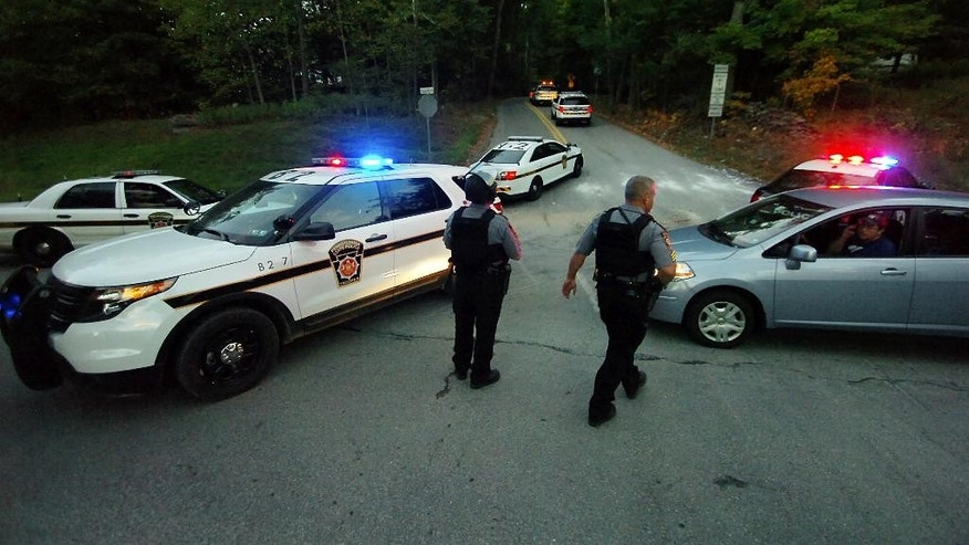 Police State Police vehicles speed up Snow Hill Road on Route 447 in Price Township on Sunday, Sept. 21, 2014, near Canadensis, Pa., Both roads were closed for several hours during the massive search for suspected killer Eric Frein.  (AP Photo / The Scranton Times-Tribune, Butch Comegys)