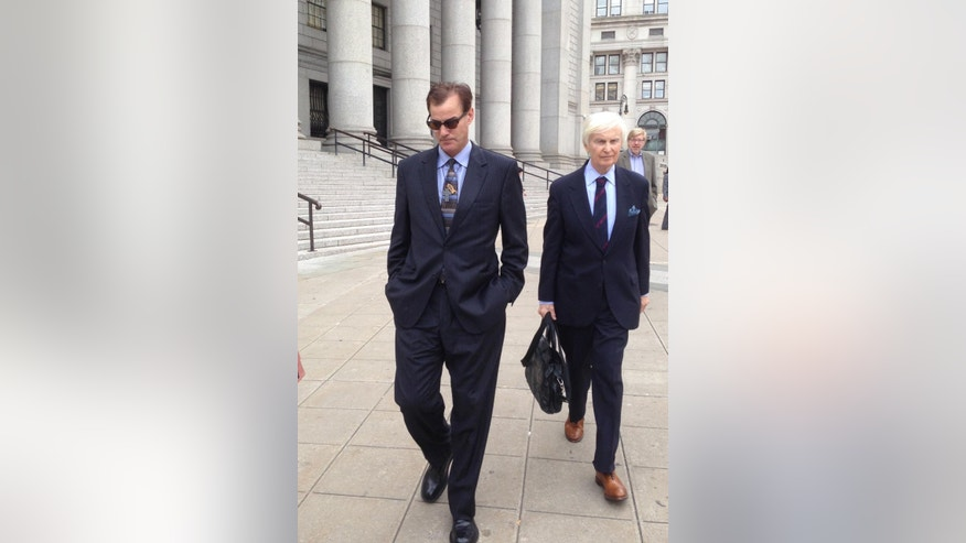 Michael Lucarelli, left, walks away from federal court in Manhattan with his attorney, Patrick W. McGinley, left, at his side after pleading guilty to an insider trading charge Wednesday, Sept 24, 2014, in New York. Sentencing was set for Jan. 8. Lucarelli's exit contrasted with his attempt to flee photographers only weeks earlier after his arrest, when he ran out of his sandals as he raced down a sidewalk in slacks and a tank top.  (AP Photo/Larry Neumeister)